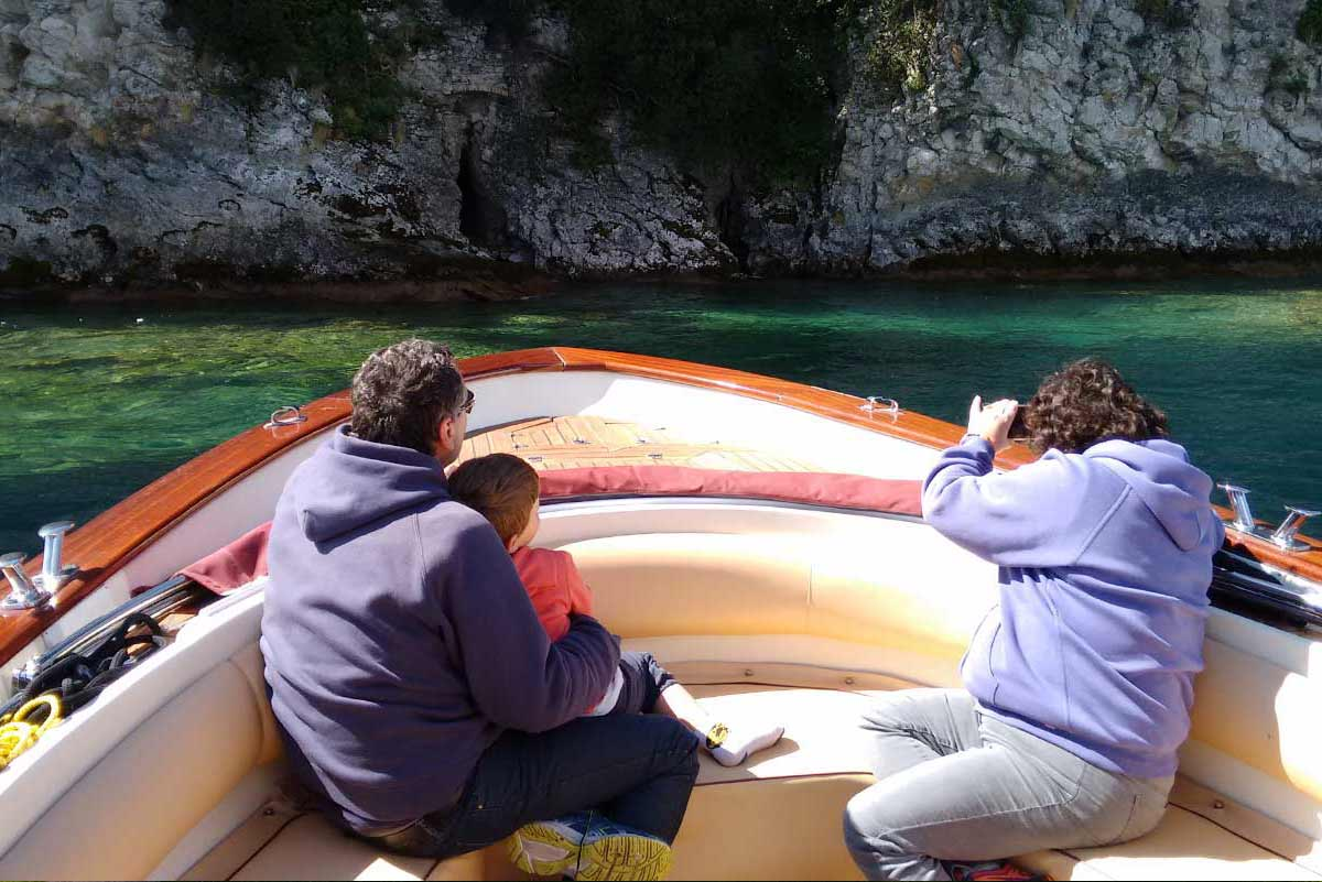 Family Boat Tours in front of the caves